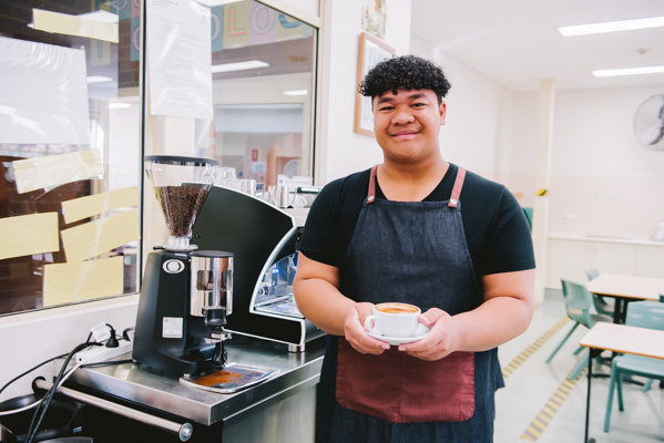 Holy Spirit Catholic College Lakemba student holding a cup of coffee
