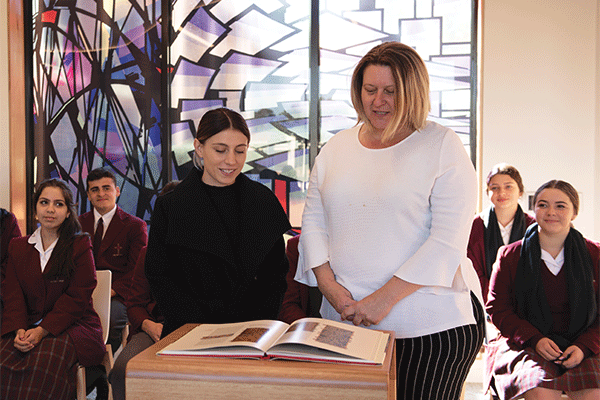 Lakemba-Holy-Spirit-staff-reading from book